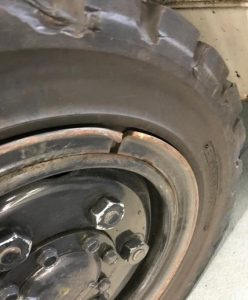 Damage to this wheel's split-rim collar could put the driver and others at risk.